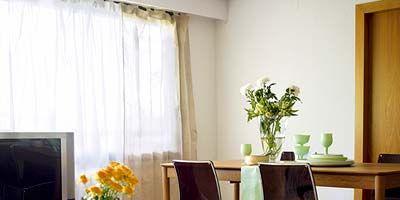 Room, Interior design, Furniture, Table, Television set, Flower, Display device, Interior design, Flat panel display, Vase,