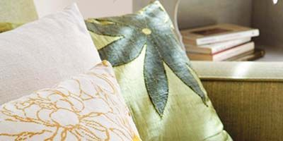 Yellow, Textile, Room, Interior design, Linens, Cushion, Home accessories, Teal, Bedding, Pillow,
