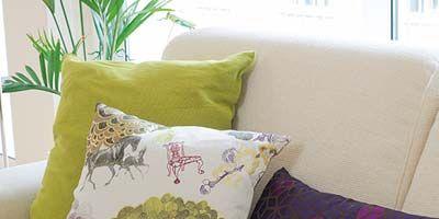 Yellow, Green, Room, Textile, Purple, Cushion, Interior design, Pillow, Linens, Throw pillow,
