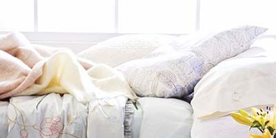 White, Bedding, Bed sheet, Product, Bed, Furniture, Textile, Yellow, Room, Linens,