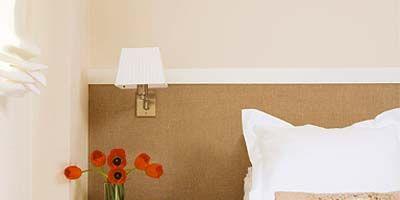 Room, Interior design, Yellow, Property, Textile, Wall, Linens, Furniture, Lamp, Petal,