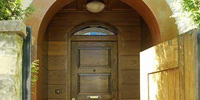 Wood, Yellow, Architecture, Property, Door, Arch, Home door, Wall, Wood stain, Hardwood,
