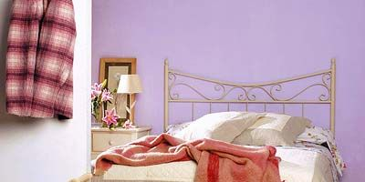 Room, Interior design, Bed, Bedding, Textile, Linens, Bedroom, Floor, Bed sheet, Bed frame,
