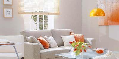 Room, Interior design, Yellow, Orange, Floor, Wall, Home, Furniture, Living room, Table,