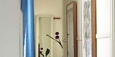 Wood, Room, Interior design, Wall, Flooring, Floor, Fixture, Wood stain, Handle, Home door,