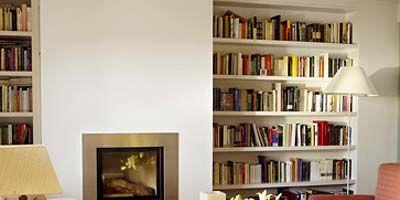Room, Interior design, Shelf, Wood, Property, Wall, Textile, Shelving, Furniture, Bedding,