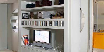 Room, Interior design, Property, Display device, Orange, Wall, Floor, Dishware, Serveware, Home,