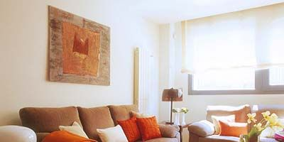 Room, Interior design, Living room, Furniture, Wall, Table, Floor, Couch, Orange, Home,