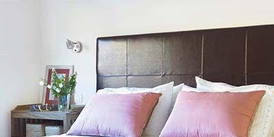 Bed, Room, Interior design, Wood, Brown, Wall, Bedding, Property, Bedroom, Textile,