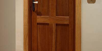 Wood, Brown, Hardwood, Wood stain, Pattern, Wall, Home door, Fixture, Tan, Varnish,