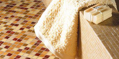 Flooring, Textile, Floor, Linens, Tile, Home accessories, Beige, Tile flooring, Mat, Towel,