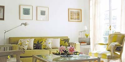 Room, Interior design, Yellow, Floor, Living room, Table, Furniture, Home, Couch, Wall,