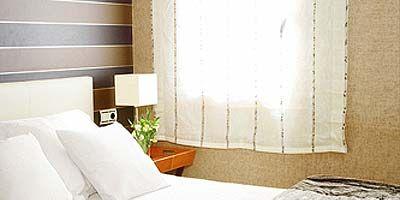 Room, Bed, Interior design, Property, Wall, Textile, Bedding, Bedroom, Real estate, Linens,