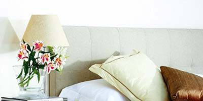 Room, Textile, Wall, Interior design, White, Furniture, Petal, Drawer, Linens, Chest of drawers,
