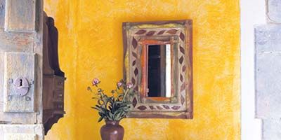 Yellow, Room, Drawer, Wall, Interior design, Furniture, Flowerpot, Cabinetry, Chest of drawers, Paint,
