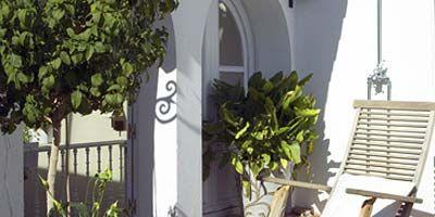 Property, Real estate, Flowerpot, Shrub, Home fencing, Arch, Houseplant, Door, Garden, Backyard,