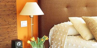 Room, Property, Lampshade, Interior design, Wall, Lamp, Lighting accessory, Linens, Home accessories, Orange,