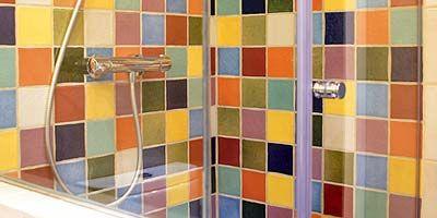 Yellow, Tile, Wall, Colorfulness, Orange, Rectangle, Bathroom, Tile flooring, Paint, Plumbing fixture,
