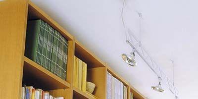 Wood, Room, Yellow, Shelf, Property, Wall, Shelving, Bookcase, Publication, Interior design,
