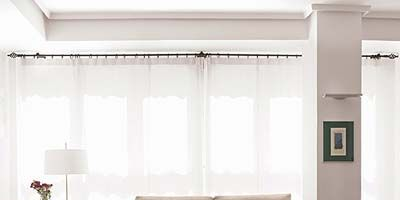 Room, Interior design, Wall, Floor, Living room, Window covering, Table, White, Ceiling, Couch,