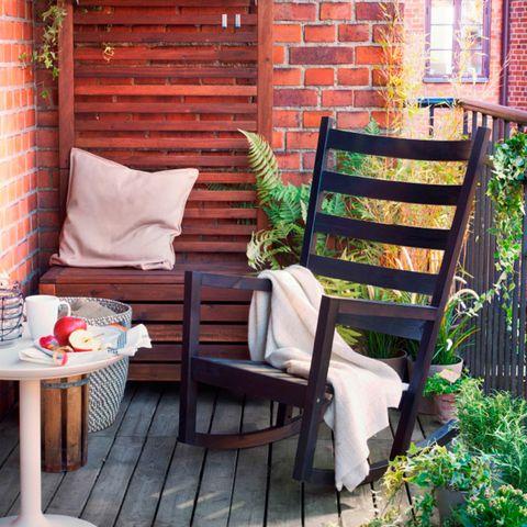 Wood, Brick, Furniture, Table, Outdoor furniture, Hardwood, Brickwork, Home, Pillow, Groundcover,