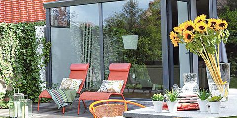 Furniture, Table, Chair, Outdoor furniture, Orange, Outdoor table, Flowerpot, Bouquet, Flower Arranging, Cut flowers,