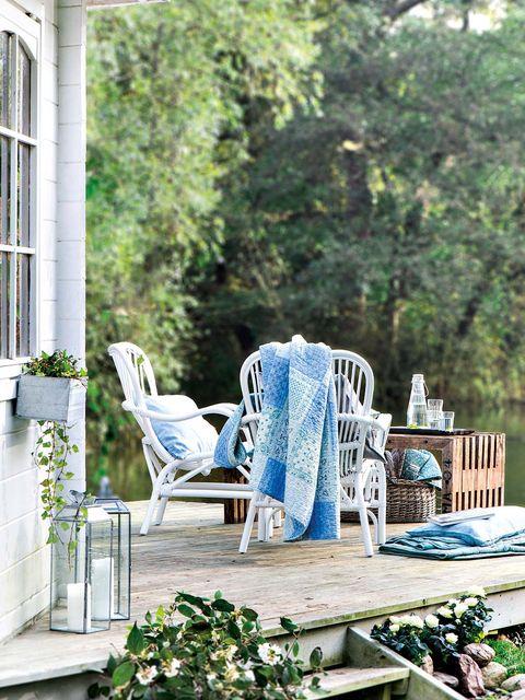 Blue, Furniture, Chair, Outdoor furniture, Teal, Home, Armrest, Patio, Pillow, Throw pillow,