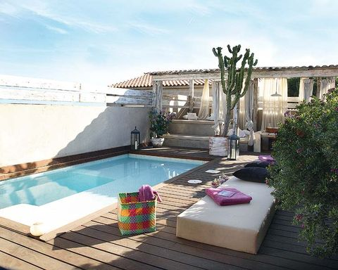 Swimming pool, Fluid, Real estate, Villa, Outdoor furniture, Composite material, Aqua, Rectangle, Resort, Courtyard,