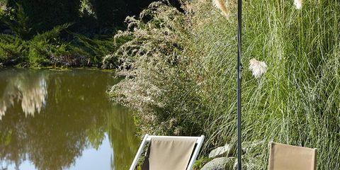 Natural landscape, Furniture, Pond, Outdoor furniture, Chair, Garden, Folding chair, Wetland, Reservoir, Armrest,