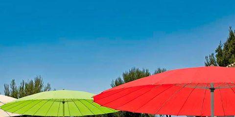Swimming pool, Property, Umbrella, Real estate, Resort, Shade, Azure, Aqua, Composite material, Sunlounger,