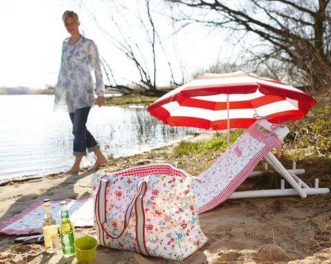 Textile, Bag, Street fashion, Beach, Outdoor furniture, Sand, Pattern, Sandal,