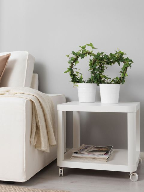 White, Furniture, Shelf, Table, Room, Nightstand, Beige, Material property, Interior design, Plant,