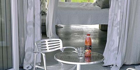 Floor, Flooring, Bottle, Hardwood, Orange, Chair, Curtain, Glass bottle, Window treatment, Beer,
