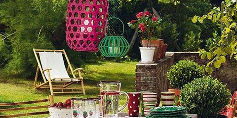 Furniture, Outdoor furniture, Flowerpot, Table, Outdoor table, Easel, Garden, Houseplant, Folding chair, Backyard,