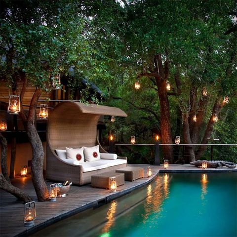 Swimming pool, Property, Lighting, Resort, Home, Landscape lighting, House, Leisure, Tree, Backyard,