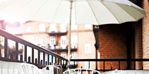 White, Furniture, Table, Chair, Restaurant, Outdoor table, Balcony, Iron, Design, Umbrella,