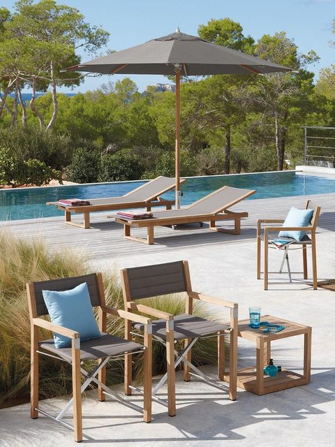 Furniture, Outdoor furniture, Sunlounger, Resort, Shade, Swimming pool, Outdoor table, Resort town, Armrest, Outdoor structure,
