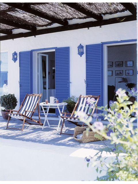 Blue, Outdoor furniture, Furniture, Real estate, House, Shade, Door, Outdoor table, Home, Sunlounger,
