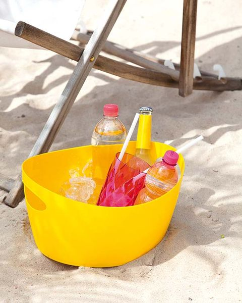 Yellow, Bottle, Orange, Cone, Peach, Glass bottle, Plastic, Sand,