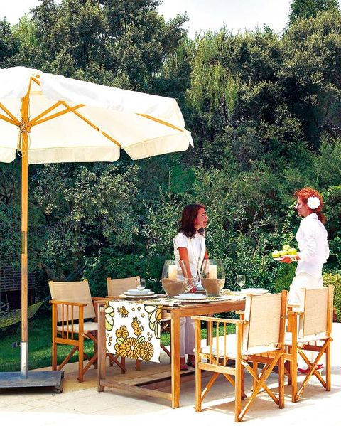 Furniture, Table, Outdoor furniture, Outdoor table, Sitting, Shade, Kitchen & dining room table, Outdoor structure, Patio, Yard,