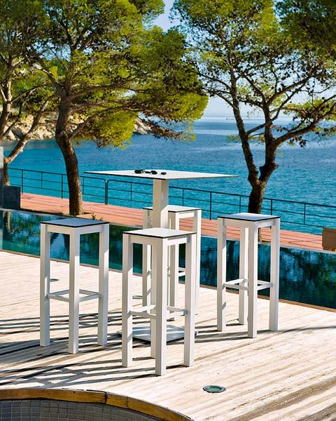Table, Turquoise, Furniture, Tree, Outdoor furniture, Leisure, Deck, Chair, Architecture, Wood,
