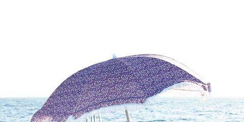 Water, Ocean, Outdoor furniture, Beach, Sea, Umbrella, Shore, Wave, Shade, Wind wave,