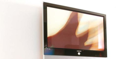 Display device, Room, Wood, Flat panel display, Electronic device, Television set, Interior design, Wall, Computer monitor accessory, Led-backlit lcd display,