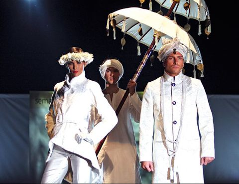 Dress shirt, Hat, Fashion, Sun hat, Costume design, Drama, Stage, Acting, heater, Suit trousers,