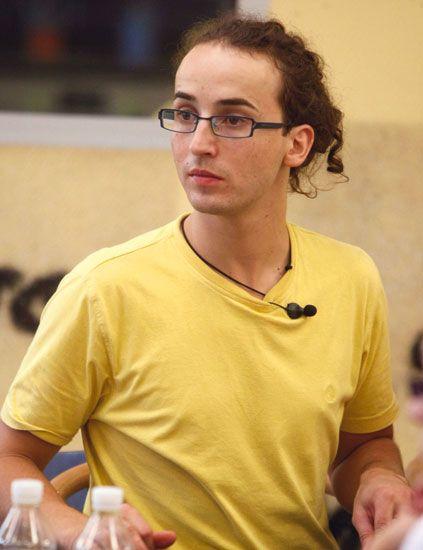 Eyewear, Glasses, Vision care, Shoulder, T-shirt, Bottle, Plastic bottle, Brown hair, Top, Active shirt,
