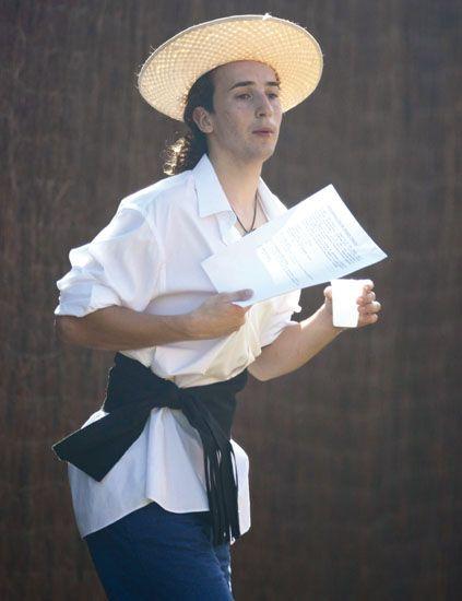 Arm, Sleeve, Hat, Collar, Dress shirt, Shirt, Hand, Elbow, Headgear, Sun hat,