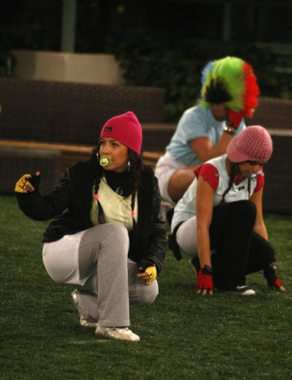 Headgear, Thigh, Knee, Pom-pom, Active pants, Sock, Beanie, Football equipment, sweatpant, Glove,