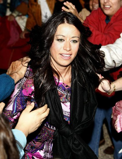 Hairstyle, Hand, Fashion accessory, Fashion, Black hair, Long hair, Body jewelry, Leather jacket, Layered hair, Makeover,