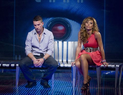 Leg, Shirt, Dress shirt, Sitting, Dress, Stage, Television program, Television presenter, Conversation, Electric blue,