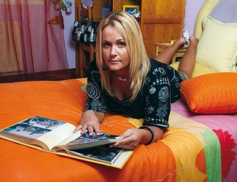 Textile, Curtain, Publication, Orange, Interior design, Linens, Cabinetry, Book, Paper, Paper product,